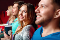 Woman with coke in cinema between viewer Stock Photo