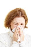 Woman with a cold. Woman cleaning her nose with a tissue Royalty Free Stock Photos