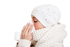 Woman with a cold. Blowing her nose with a handkerchief Royalty Free Stock Photo