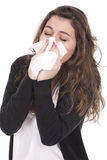 Woman with a cold blowing nose Stock Image