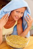 Woman with cold inhaled chamomile Royalty Free Stock Image