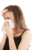 Woman with cold sneezing Stock Photos
