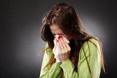 Woman with cold sneezing Stock Photo