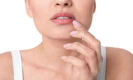 Woman with cold sore touching lips. On white background, closeup stock images