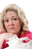 Woman with cold & tissues Royalty Free Stock Photos