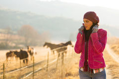 Woman cold winter morning. Beautiful young woman at horse farm in the cold winter morning Royalty Free Stock Photography