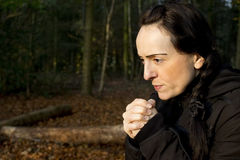Woman cold in woods Stock Photography