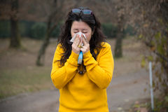 Woman with colds Stock Image