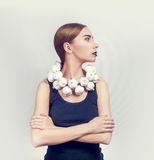 Woman with a collar of white garlic Royalty Free Stock Photography