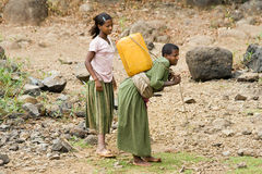 Woman collect water, Ethiopia. Stock Photography