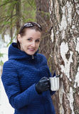 Woman collecting birch SAP Royalty Free Stock Images