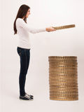 Woman collecting coins. Woman holding coin and stacking it together Stock Photo