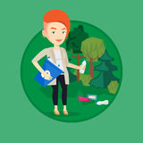 Woman collecting garbage in forest. Royalty Free Stock Photos