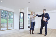 Woman Collecting Keys To New Home From Estate Agent Stock Images