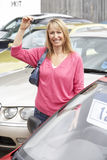 Woman collecting new car Royalty Free Stock Photos