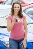Woman collecting new car Royalty Free Stock Photo