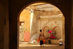 Woman collecting water in the medina stock image