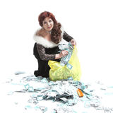 Woman collects money into the package. Lamorous woman with a bag of money on a white background stock image