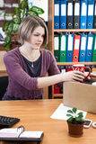 Woman collects things in a cardboard box. In the workplace Stock Photography