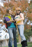 Woman With College Friend Using Cell Phone Stock Photos