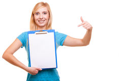 Woman college student girl holds clipboard and points Royalty Free Stock Photography