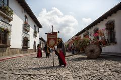 Woman in colonial dress on the street of Antigua Guatemala. February 8, 2015 Antigua, Guatemala: the coloniak architecture and cobblestone streets are very Stock Photos