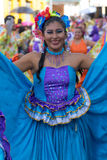 Woman in colonial style dress in Ecuador. June 17, 2017 Pujili, Ecuador: closeup of a female dancer with colourful traditional clothing  at the Corpus Christi Royalty Free Stock Photo