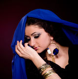Woman in color arabian clothes Stock Images