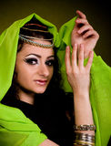 Woman in color arabian clothes Stock Photos