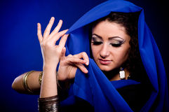 Woman in color arabian clothes Royalty Free Stock Images