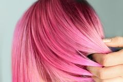 Woman with color dyed hair, close up view. Trendy hairstyle royalty free stock photography