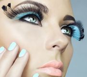 Woman with color eyelashes. Closeup portrait of beautiful woman with color eyelashes. Makeup and manicure Royalty Free Stock Photos