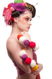 Woman with color face art in knitting style royalty free stock photography