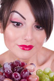 Woman with color grape Royalty Free Stock Photos