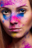 Woman with color powder on face fashion make up Royalty Free Stock Photo
