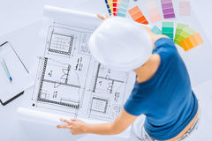 Woman with color samples and blueprint Stock Photo
