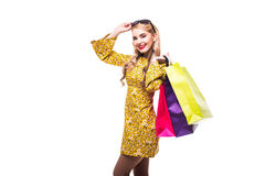Woman with color shoping bags isolated on white. Woman with color bags isolated on white royalty free stock photos