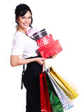 Woman with color shopping bags and boxes. Royalty Free Stock Photography