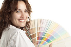 Woman with Color Swatch. Smiling Woman with Color Swatch, Isolated on White Royalty Free Stock Photography