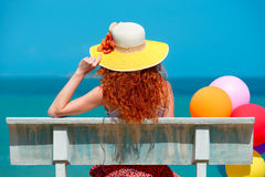 Woman with colored balloons dreams. Stock Photo
