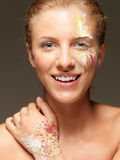Woman colored powders on face and hand Stock Photos