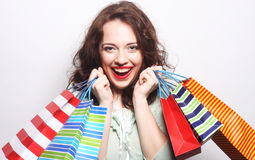 Woman with colored shopping bags. Portrait of a beautiful woman with colored shopping bags Royalty Free Stock Image