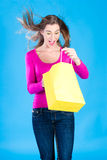 Woman with colored shopping bags Royalty Free Stock Photos