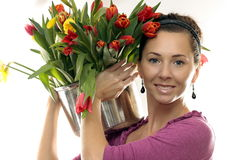 Woman with Colored Tulips. Isolated on white Stock Images