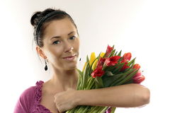 Woman with Colored Tulips. Isolated on white Stock Photos
