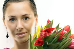 Woman with Colored Tulips. Attractive Woman with Colored Tulips Stock Images