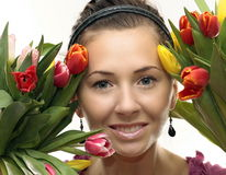 Woman with Colored Tulips. Attractive Woman with Colored Tulips Royalty Free Stock Photos