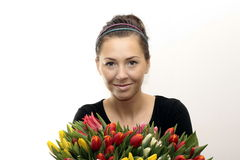 Woman with Colored Tulips. Isolated on white Stock Photography
