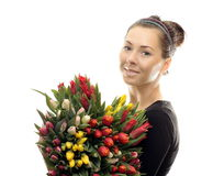 Woman with Colored Tulips Stock Image
