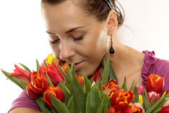 Woman with Colored Tulips Stock Photo